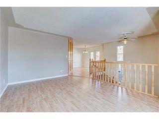 Photo 3: 313 WINDSOR Avenue: Turner Valley House for sale : MLS®# C4099234