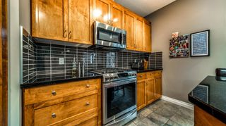 Photo 20: 38 Somme Boulevard SW in Calgary: Garrison Woods Row/Townhouse for sale : MLS®# A1112371