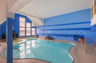 Photo 32: 1409 151 Country Village Road NE in Calgary: Country Hills Village Apartment for sale : MLS®# A1078833
