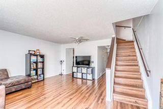 Photo 4: 37 Range Gardens NW in Calgary: Ranchlands Row/Townhouse for sale : MLS®# A1118841