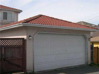 Photo 2: 4968 SOMERVILLE ST in Vancouver: Fraser VE House for sale (Vancouver East)  : MLS®# V999735