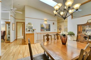 Photo 12: 20A Woodmeadow Close SW in Calgary: Woodlands Row/Townhouse for sale : MLS®# A1127050