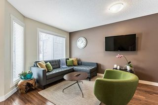 Photo 3: 1562 93 Street SW in Calgary: Aspen Woods Row/Townhouse for sale : MLS®# A1085332