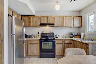 Photo 7: 203 DEERPOINT Lane SE in Calgary: Deer Ridge Row/Townhouse for sale : MLS®# C4288291
