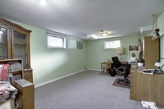 Photo 31: 7011 HUNTERVILLE Road NW in Calgary: Huntington Hills Semi Detached for sale : MLS®# A1035276