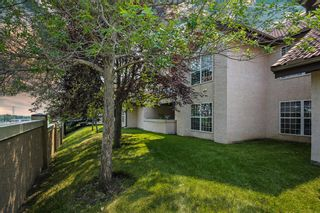 Photo 21: 1004 1997 Sirocco Drive SW in Calgary: Signal Hill Row/Townhouse for sale : MLS®# A1132991