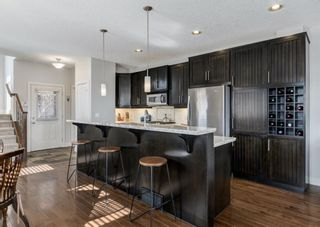 Photo 9: 106 1312 Russell Road NE in Calgary: Renfrew Row/Townhouse for sale : MLS®# A1080835