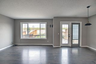 Photo 12: 566 River Heights Crescent: Cochrane Semi Detached for sale : MLS®# A1129968