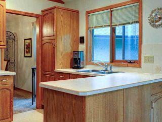 Photo 9: 112 OAKBRIAR Close SW in CALGARY: Palliser Townhouse for sale (Calgary)  : MLS®# C3576758