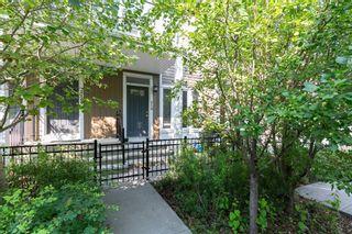Photo 1: 218 Auburn Bay Square SE in Calgary: Auburn Bay Row/Townhouse for sale : MLS®# A1141951