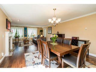"Photo 2: 228 13880 70 Avenue in Surrey: East Newton Condo for sale in ""Chelsea Gardens"" : MLS®# R2563447"