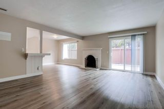 Photo 2: UNIVERSITY CITY Townhouse for sale : 3 bedrooms : 9773 Genesee Ave in San Diego