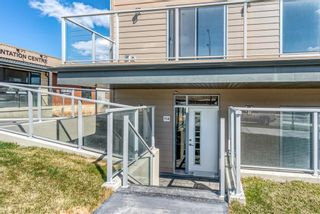 Photo 2: 114 71 Shawnee Common SW in Calgary: Shawnee Slopes Apartment for sale : MLS®# A1099362