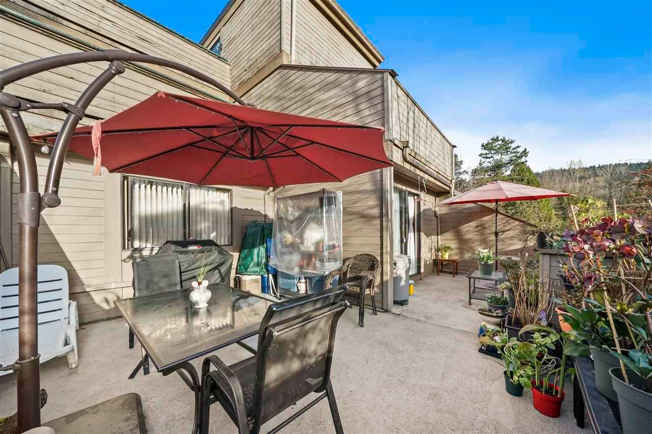 """Main Photo: 101 9151 SATURNA Drive in Burnaby: Simon Fraser Hills Townhouse for sale in """"Mountain Wood"""" (Burnaby North)  : MLS®# R2561706"""