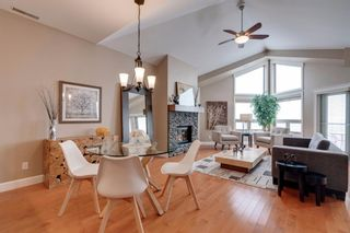 Photo 2: 34 Cougar Ridge Landing SW in Calgary: Cougar Ridge Row/Townhouse for sale : MLS®# A1075174