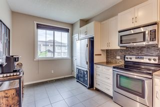 Photo 10: 54 Evansview Road NW in Calgary: Evanston Row/Townhouse for sale : MLS®# A1116817