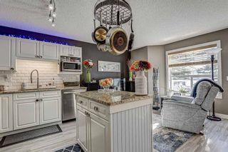 Photo 5: 183 Mt Douglas Manor SE in Calgary: McKenzie Lake Row/Townhouse for sale : MLS®# A1071755