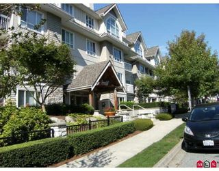 """Photo 1: 404 1685 152A Street in Surrey: King George Corridor Condo for sale in """"SUNCLIFF PLACE"""" (South Surrey White Rock)  : MLS®# F2920850"""