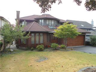 Photo 1: 7366 UNION Street in Burnaby: Simon Fraser Univer. House for sale (Burnaby North)  : MLS®# V994793