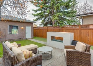 Photo 1: 2015 6 Avenue NW in Calgary: West Hillhurst Semi Detached for sale : MLS®# A1105815
