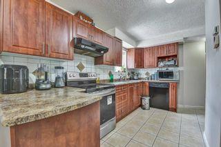 Photo 7: 7766 BURRIS Street in Burnaby: Burnaby Lake House for sale (Burnaby South)  : MLS®# R2603254