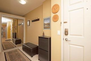 Photo 10: 1202 92 Crystal Shores Road: Okotoks Apartment for sale : MLS®# A1027921