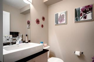 Photo 16: 15 West Coach Manor SW in Calgary: West Springs Row/Townhouse for sale : MLS®# A1100327