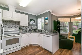 """Photo 15: 413 13900 HYLAND Road in Surrey: East Newton Townhouse for sale in """"Hyland Grove"""" : MLS®# R2589774"""
