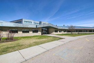 Photo 40: 226 Quigley Drive: Cochrane Semi Detached for sale : MLS®# A1107845