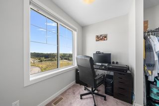 Photo 19: 1404 Jumping Pound Common: Cochrane Row/Townhouse for sale : MLS®# A1146897