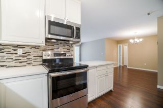 """Photo 6: 102 5379 205 Street in Langley: Langley City Condo for sale in """"Heritage Manor"""" : MLS®# R2447555"""