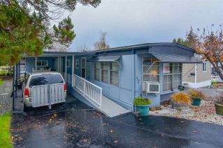 Photo 1: 111 8220 KING GEORGE Boulevard in Surrey: Bear Creek Green Timbers Manufactured Home for sale : MLS®# R2516723