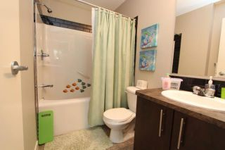Photo 14: 602 2445 KINGSLAND Road SE: Airdrie Townhouse for sale : MLS®# C3624049