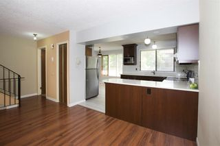 Photo 9: 1 10 POINT Drive NW in Calgary: Point McKay Row/Townhouse for sale : MLS®# A1089848