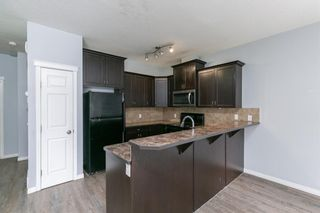 Photo 8: 58 Arbours Circle NW: Langdon Row/Townhouse for sale : MLS®# A1137898