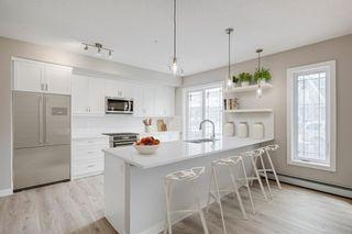 Photo 2: 111 100 Auburn Meadows Manor SE in Calgary: Auburn Bay Apartment for sale : MLS®# A1040865
