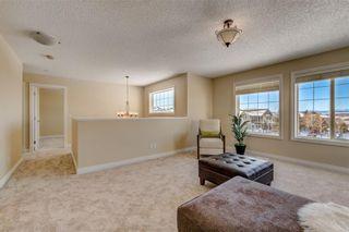 Photo 30: 204 SUNTERRA Boulevard: Cochrane House for sale : MLS®# C4164735
