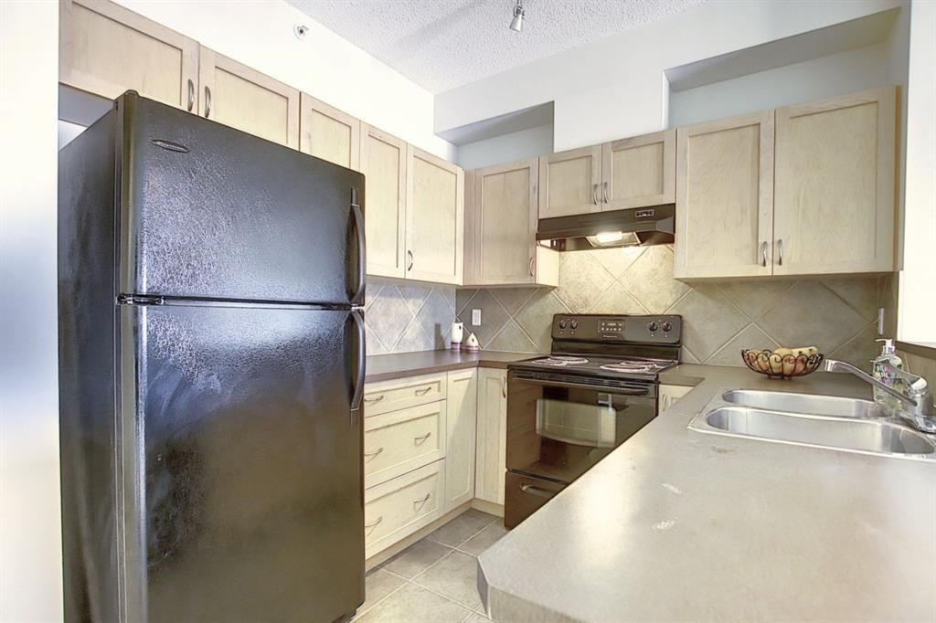 Main Photo: 8307 70 Panamount Drive NW in Calgary: Panorama Hills Apartment for sale : MLS®# A1087001