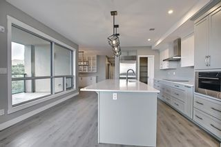 Photo 6: 317 15 Cougar Ridge Landing SW in Calgary: Patterson Apartment for sale : MLS®# A1121388