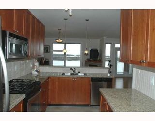 """Photo 7: 319 4600 WESTWATER Drive in Richmond: Steveston South Condo for sale in """"COPPERSKY"""" : MLS®# V694436"""