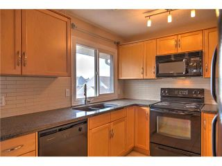 Photo 19: 248 54 GLAMIS Green SW in Calgary: Glamorgan House for sale : MLS®# C4109785
