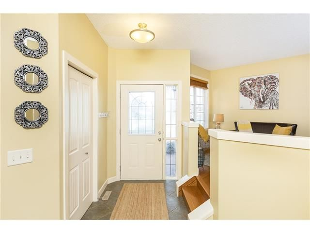 Photo 2: Photos: 664 LUXSTONE Landing SW: Airdrie House for sale : MLS®# C4106944
