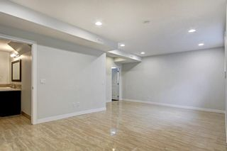 Photo 21: 93 Sidon Crescent SW in Calgary: Signal Hill Detached for sale : MLS®# A1150956