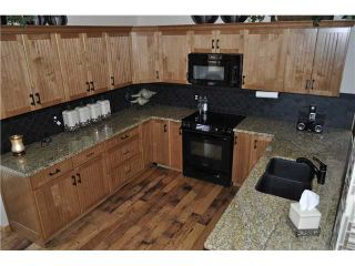 Photo 6: 245 WOODSIDE Road NW: Airdrie Residential Detached Single Family for sale : MLS®# C3635844
