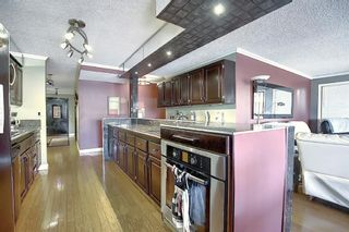 Photo 2: 806 320 Meredith Road NE in Calgary: Crescent Heights Apartment for sale : MLS®# A1062849