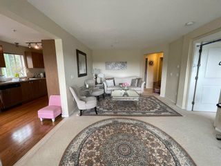 Photo 3: 306 3082 DAYANEE SPRINGS Boulevard in Coquitlam: Westwood Plateau Condo for sale : MLS®# R2601526