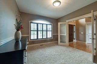 Photo 7: 32 coulee View SW in Calgary: Cougar Ridge Detached for sale : MLS®# A1117210