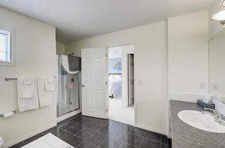 Photo 12: 3 EVERRIDGE Villa SW in Calgary: Evergreen Semi Detached for sale : MLS®# C4297700
