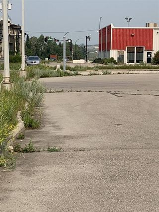 Photo 2: 544 RAILWAY Street: Cochrane Mixed Use for sale : MLS®# A1129855