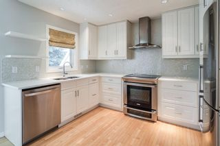 Photo 2: 1407 1 Street NE in Calgary: Crescent Heights Row/Townhouse for sale : MLS®# A1121721